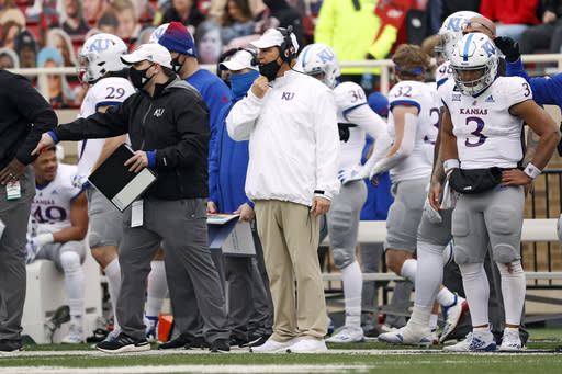 Kansas coach Les Miles yells out to the team during the second half of an NCAA college football game against Texas Tech, Saturday, Dec. 5, 2020, in Lubbock, Texas. (AP Photo/Brad Tollefson)