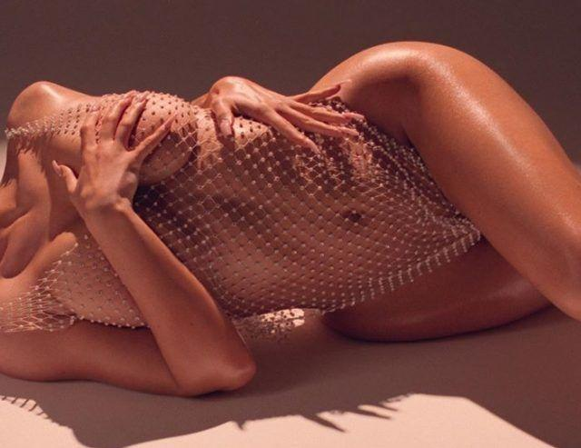 Kylie Jenner goes naked under netting