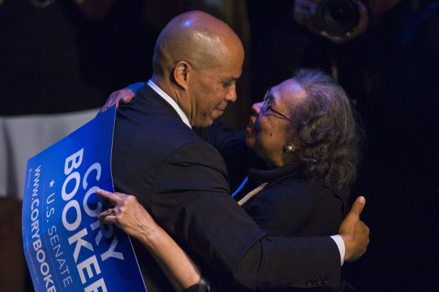 U.S. Senate candidate Cory Booker hugs his mother Carolyn after delivering a speech during his campaign's election night event in Newark, New Jersey, October 16, 2013. Democrat Booker, the charismatic mayor of Newark, was the unofficial winner of a New Jersey special election on Wednesday, handily defeating a conservative Republican to fill the state's vacant U.S. Senate seat. REUTERS/Eduardo Munoz (UNITED STATES - Tags: POLITICS ELECTIONS TPX IMAGES OF THE DAY)