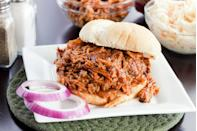 "<p><strong>Pulled Pork Sandwich</strong></p><p>At <a href=""http://currituckbbq.com/"" rel=""nofollow noopener"" target=""_blank"" data-ylk=""slk:Currituck BBQ Company"" class=""link rapid-noclick-resp"">Currituck BBQ Company</a>, there's nothing like slow-cooked pork that falls off the bone to make the perfect barbecue sandwich. True barbecue to put us in a food coma. Unlike sweet, North Carolina is known for the sauce being vinegar and pepper-based. </p>"
