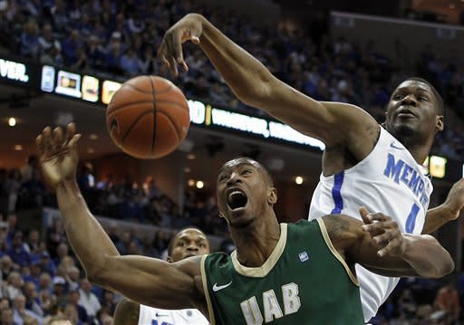 Memphis guard Adonis Thomas (4) blocks a shot by UAB guard Robert Williams, bottom, in the first half of an NCAA college basketball game on Saturday, March 9, 2013, in Memphis, Tenn. (AP Photo/Lance Murphey)