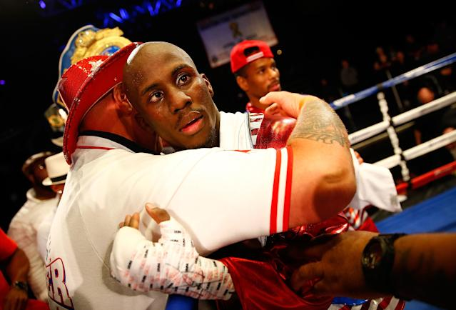 Tevin Farmer celebrates with his team following the junior lightweight win against Emmanuel Gonzalez. (Getty)