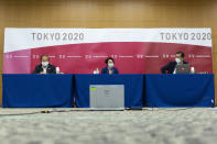 Tokyo 2020 CEO Toshiro Muto, left, and President Seiko Hashimoto, center attend the news conference after receiving a report from a group of infectious disease experts on Friday, June 18, 2021, in Tokyo. The experts including Shigeru Omi, head of a government coronavirus advisory panel, issued a report listing the risks of allowing the spectators and the measurements to prevent the event from triggering a coronavirus spread. (Yuichi Yamazaki/Pool Photo via AP)