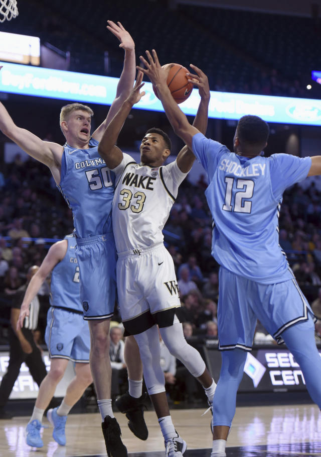 Wake Forest's Ody Oguama (33) drives to the basket under pressure from Columbia's Joseph Smoyer (50) and Cameron Shockley-Okeke (12) during an NCAA college basketball game, Sunday, Nov. 10, 2019, in Winston-Salem, N.C. (Walt Unks/Winston-Salem Journal via AP)