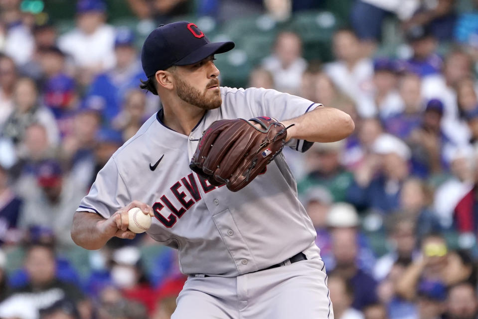 Cleveland Indians starting pitcher Aaron Civale winds up during the first inning of a baseball game against the Chicago Cubs, Monday, June 21, 2021, in Chicago. (AP Photo/Charles Rex Arbogast)