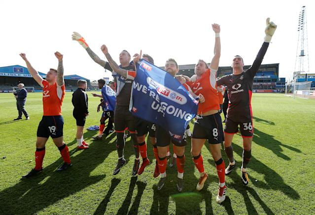 "Soccer Football - League Two - Carlisle United v Luton Town - Brunton Park, Carlisle, Britain - April 21, 2018 Luton Town players celebrate promotion after the game Action Images/John Clifton EDITORIAL USE ONLY. No use with unauthorized audio, video, data, fixture lists, club/league logos or ""live"" services. Online in-match use limited to 75 images, no video emulation. No use in betting, games or single club/league/player publications. Please contact your account representative for further details."