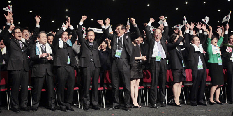 Members of the South Korean delegation at the 123rd International Olympic Comittee (IOC)  meeting in Durban Wednesday July 6, 2011 react after The IOC announced it voted for  Pyeongchang to be the host city for the 2018 Winter Olympics.The IOC voted by secret ballot from a field of three candidates - Pyeongchang, South Korea; Munich, Germany and Annecy, France. (AP Photo/Jerome Delay)