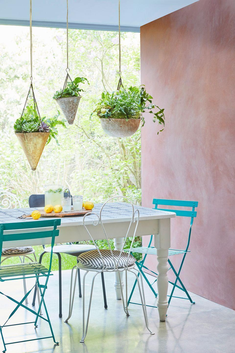 <p>Patios and porches look beautiful with a pop of color, and since they're exposed to the outdoors, they look beautiful with a more distressed finish or treatment. This sweet patio features a plaster effect wall painted with Chalk Paint® in Scandinavian Pink and Paloma. Add hanging plants for some greenery overhead. </p>