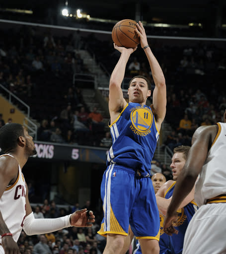 CLEVELAND, OH - JANUARY 29: Klay Thompson #11 of the Golden State Warriors shoots a jumper against the Cleveland Cavaliers at The Quicken Loans Arena on January 29, 2013 in Cleveland, Ohio. (Photo by David Liam Kyle/NBAE via Getty Images)