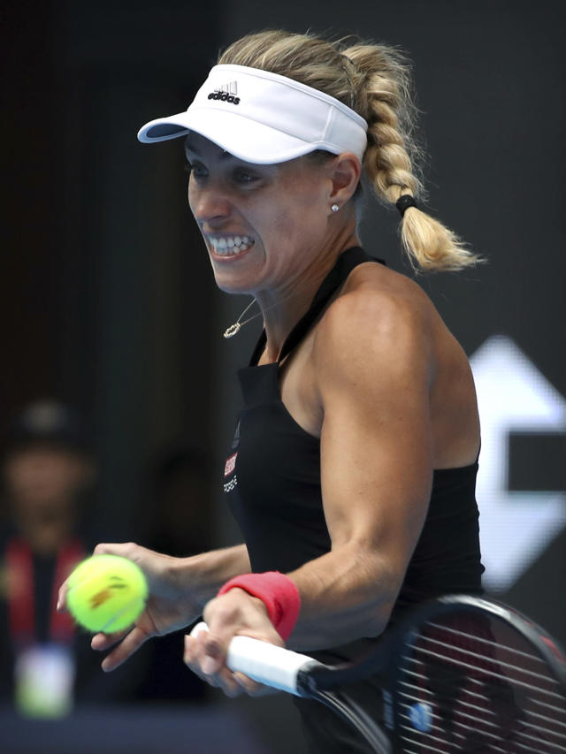 Angelique Kerber of Germany hits a return shot while competing against Zhang Shuai of China in their third round women's singles match in the China Open at the National Tennis Stadium in Beijing, Thursday, Oct. 4, 2018. (AP Photo/Mark Schiefelbein)