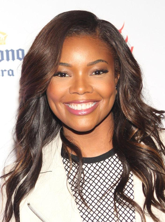 """<p><a href=""""https://www.oprahmag.com/beauty/skin-makeup/a27331184/gabrielle-union-favorite-mascara/"""" rel=""""nofollow noopener"""" target=""""_blank"""" data-ylk=""""slk:Union"""" class=""""link rapid-noclick-resp"""">Union</a> has tried blonde hair, pixie cuts, and bobs, but rich brown hues, layers, and protective styles are her go-to styles. </p>"""