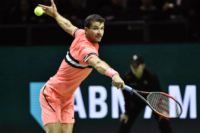 Grigor Dimitrov of Bulgaria plays a shot against Roger Federer of Switzerland in the men's singles final of the ABN AMRO world tennis tournament at the Ahoy stadium in Rotterdam, Netherlands, Sunday, Feb. 18, 2018. (AP Photo/Patrick Post)