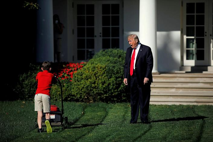 <p>SEPT. 15, 2017 – President Donald Trump welcomes 11-years-old Frank Giaccio as he cuts the Rose Garden grass at the White House in Washington. Frank, who wrote a letter to Trump offering to mow the White House lawn, was invited to work for a day at the White House along the National Park Service staff. (Photo: Carlos Barria/Reuters) </p>
