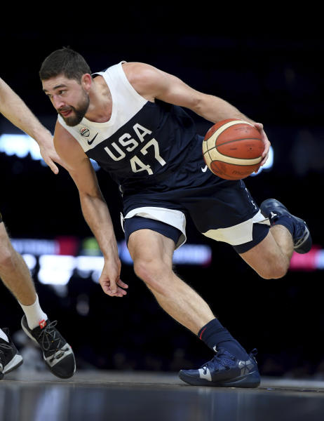 United States' Joe Harris in action against Australia during their exhibition basketball game in Melbourne, Saturday, Aug. 24, 2019. (AP Photo/Andy Brownbill)
