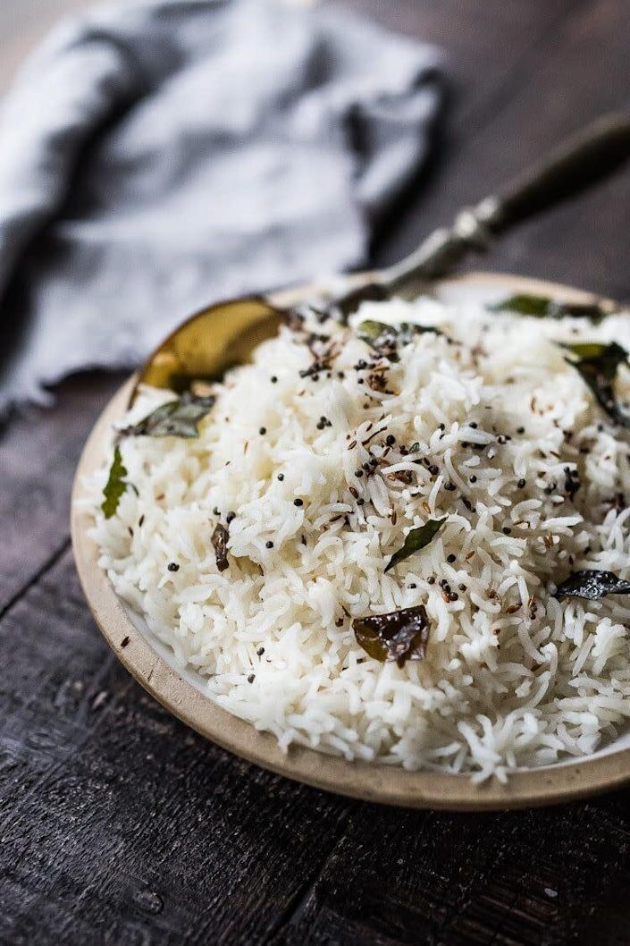 "<strong>Get the <a href=""https://www.feastingathome.com/how-to-cook-basmati-rice/"" rel=""nofollow noopener"" target=""_blank"" data-ylk=""slk:Fluffy Basmati Rice recipe"" class=""link rapid-noclick-resp"">Fluffy Basmati Rice recipe</a> from Feasting at Home</strong>"