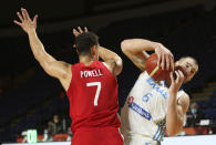 Canada's Dwight Powell tries to block Greece's Vassilis Kavvadas during the first half of a FIBA men's Olympic qualifying basketball game Tuesday, June 29, 2021 at Memorial Arena in Victoria, British Columbia. (Chad Hipolito/The Canadian Press via AP)