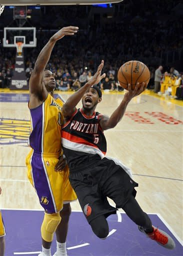 Portland Trail Blazers guard Will Barton, right, puts puts up a shot as Los Angeles Lakers forward Earl Clark defends during the first half of their NBA basketball game, Friday, Feb. 22, 2013, in Los Angeles. (AP Photo/Mark J. Terrill)