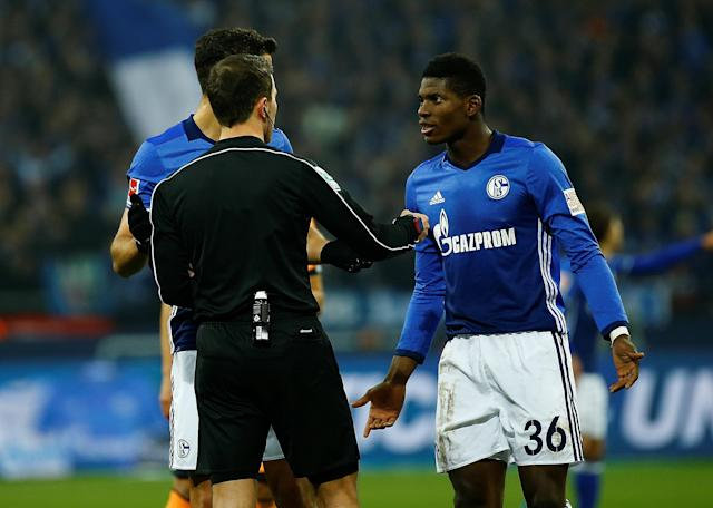 Soccer Football - Bundesliga - Schalke 04 vs TSG 1899 Hoffenheim - Veltins-Arena, Gelsenkirchen, Germany - February 17, 2018 Schalke's Breel Embolo appeals to referee Benjamin Brand after his goal was disallowed following consultation with the video assistant referee REUTERS/Leon Kuegeler DFL RULES TO LIMIT THE ONLINE USAGE DURING MATCH TIME TO 15 PICTURES PER GAME. IMAGE SEQUENCES TO SIMULATE VIDEO IS NOT ALLOWED AT ANY TIME. FOR FURTHER QUERIES PLEASE CONTACT DFL DIRECTLY AT + 49 69 650050