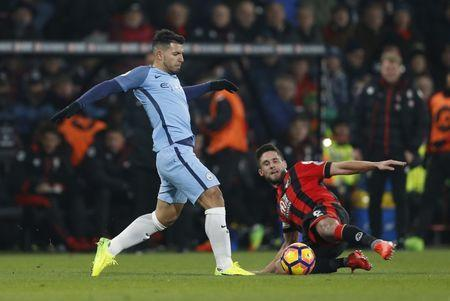 Manchester City's Sergio Aguero in action with Bournemouth's Andrew Surman