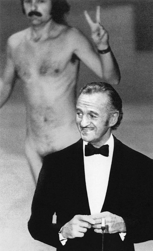 "The streaker (1974): Just as host David Niven was about to introduce Elizabeth Taylor, a naked man came running across the stage behind him, flashing a peace sign. (It was the '70s.) The whole place naturally went wild with laughter, but Niven, being the epitome of British class and cool, didn't miss a beat. He deadpanned: ""Well, ladies and gentlemen, that was almost bound to happen. But isn't it fascinating to think that probably the only laugh that man will ever get in his life is by stripping off and showing his shortcomings?"""