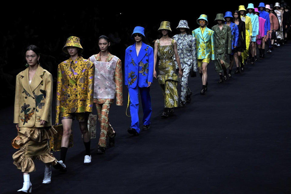 Models present creations by Chinese designer Zheng Wei in her Mackzheng collection during the China Fashion Week in Beijing, Sunday, Sept. 12, 2021. (AP Photo/Andy Wong)