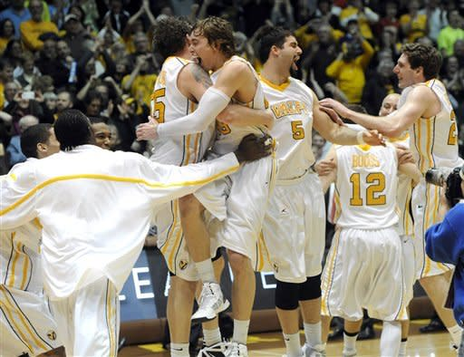 Valparaiso players react after their 62-54 win in a NCAA college basketball game with Wright State for the Horizon League Championship Tuesday March 12, 2013 in Valparaiso, Ind. (AP Photo/Joe Raymond)