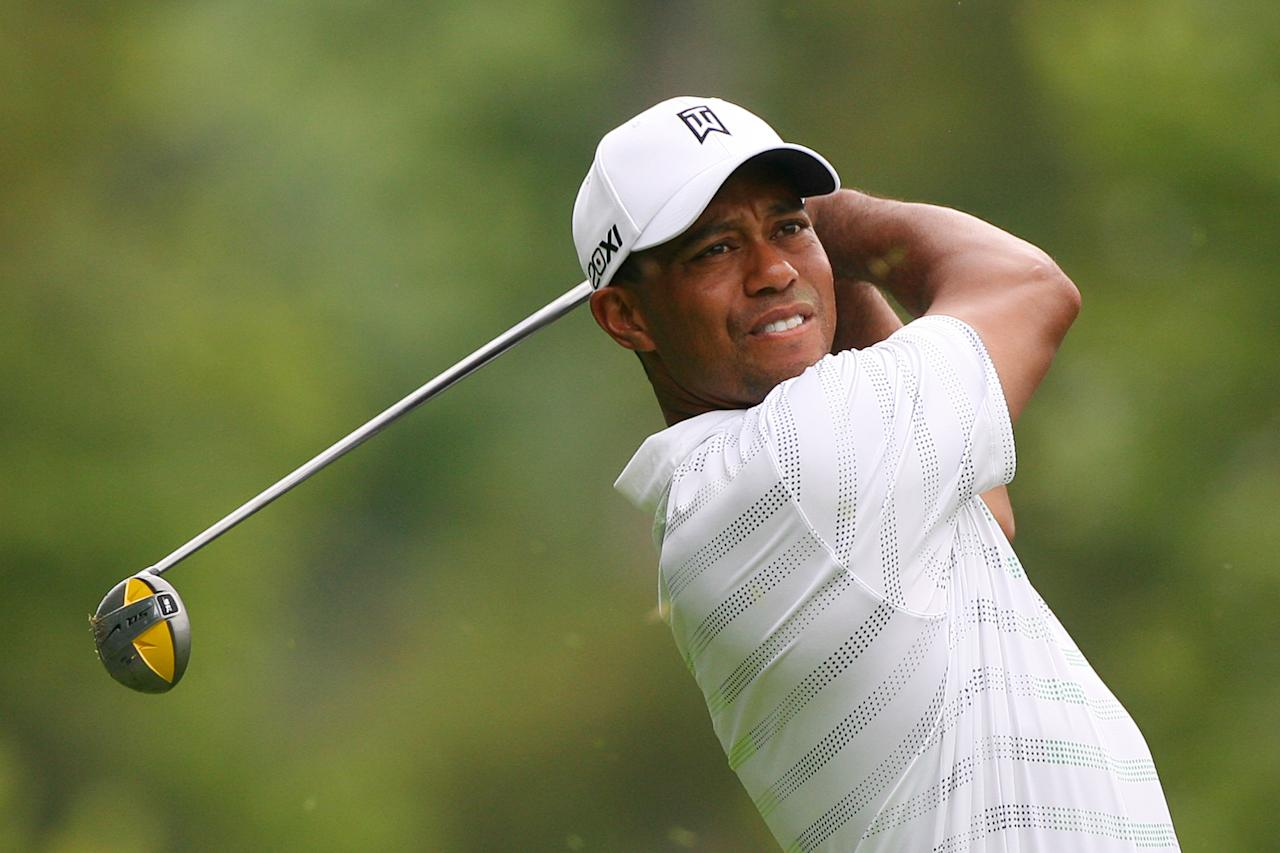 WHITE SULPHUR SPRINGS, WV - JULY 5: Tiger Woods hits his tee shot on the fourth hole during the first round of the Greenbrier Classic at the Old White TPC on July 5, 2012 in White Sulphur Springs, West Virginia. (Photo by Hunter Martin/Getty Images)