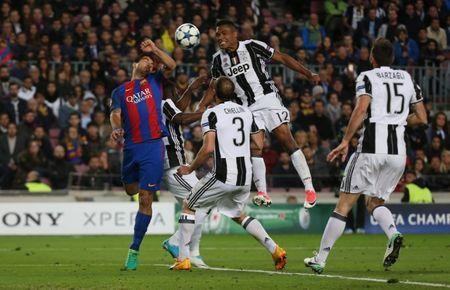Barcelona's Luis Suarez in action with Juventus' Alex Sandro