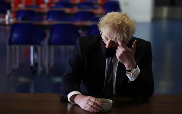 Boris Johnson during a visit to a school in London today - Getty