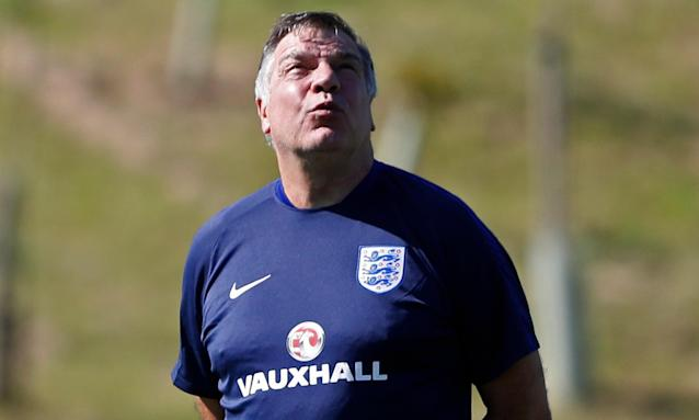 It is the day before England's opening match of the World Cup and Sam Allardyce takes a moment during training to admire just how massive Andy Carroll is.