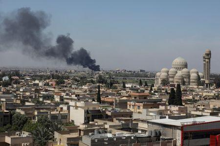 A smoke rises as Iraqi forces fight Islamic State militants in Mosul
