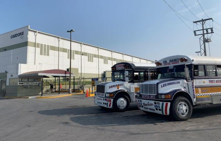Commuter buses are parked outside the Tridonex auto-parts plant, owned by Philadelphia-based Cardone Industries, in Matamoros
