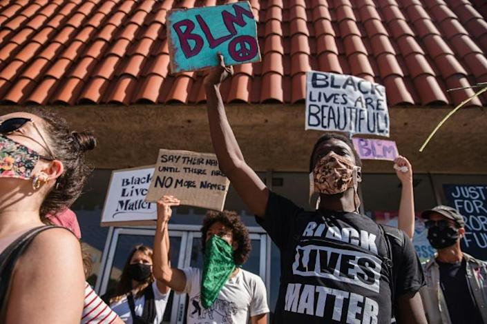 Demonstrators marched in the California town of Palmdale demanding justice for Robert Fuller, a black man who was recently found dead and hanging from a tree (AFP Photo/ARIANA DREHSLER)
