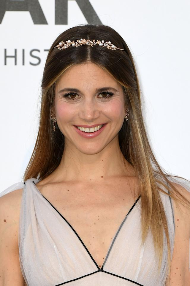 <p>Nicoletta Romanoff's simple yet sophisticated headband adds flair. (Photo: Getty Images) </p>