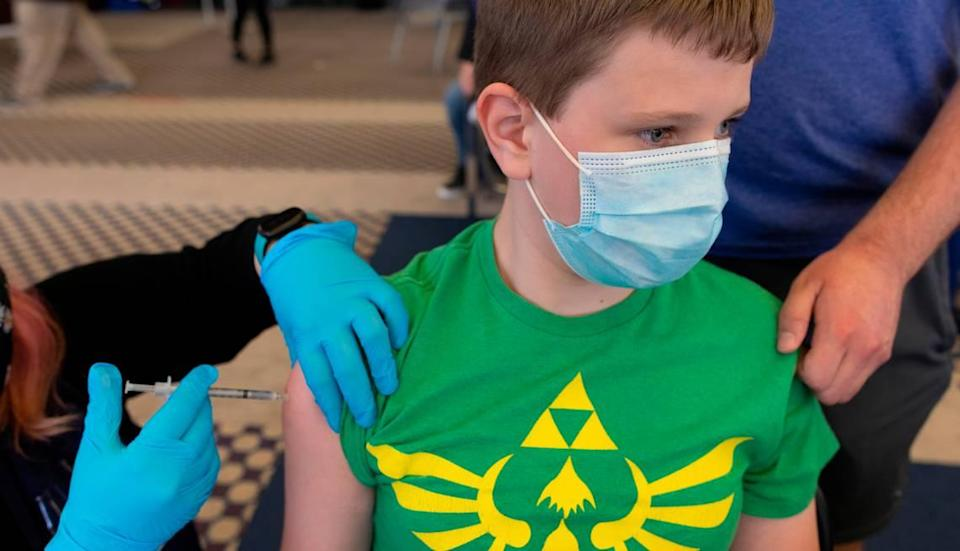 Jacob Wentling, 12, gets the Pfizer shot at a Wichita vaccination site. That's the youngest age vaccines are allowed, for now.