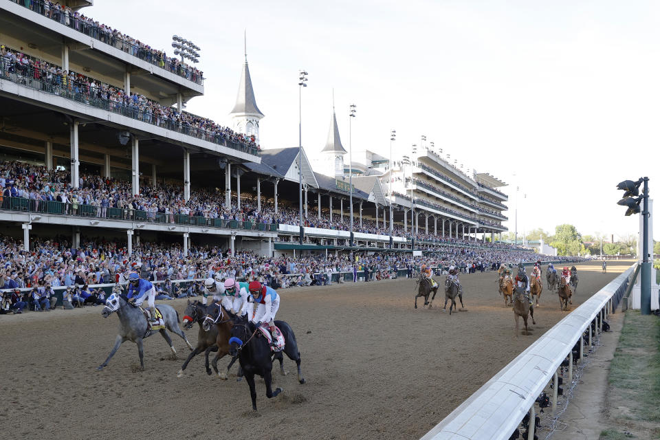 LOUISVILLE, KENTUCKY - MAY 01: Medina Spirit #8, ridden by jockey John Velazquez, crosses the finish line to win the 147th running of the Kentucky Derby ahead of Mandaloun #7, ridden by Florent Geroux, and Hot Rod Charlie #9 ridden by Flavien Prat , and Essential Quality #14, ridden by Luis Saez, at Churchill Downs on May 01, 2021 in Louisville, Kentucky. (Photo by Tim Nwachukwu/Getty Images)