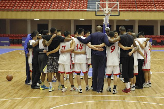 Dennis Rodman huddles with North Korean basketball players and fellow former NBA stars at a practice session in Pyongyang, North Korea on Tuesday, Jan. 7, 2014. Rodman came to the North Korean capital with a squad of U.S. basketball stars for an exhibition game on Jan. 8, the birthday of North Korean leader Kim Jong Un. (AP Photo/Kim Kwang Hyon)
