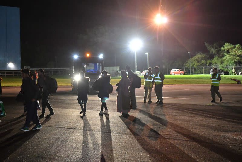 British nationals and Afghan evacuees arrive on a flight from Afghanistan at RAF Brize Norton