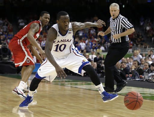 Kansas guard Tyshawn Taylor (10) chases a loose ball past Ohio State guard William Buford during the second half of an NCAA Final Four semifinal college basketball tournament game Saturday, March 31, 2012, in New Orleans. (AP Photo/David J. Phillip) 44