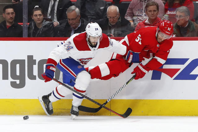 Detroit Red Wings center Frans Nielsen (51) passes as he is upended by Montreal Canadiens center Phillip Danault (24) in the first period of an NHL hockey game, Tuesday, Feb. 26, 2019, in Detroit. (AP Photo/Paul Sancya)