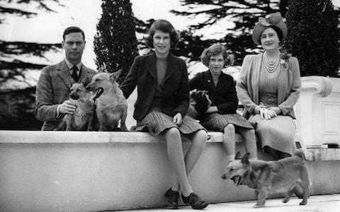 King George VI and Queen Elizabeth with their daughters Princess Elizabeth and Princess Margaret in the ground of the Royal Lodge - Credit:  Getty Creative