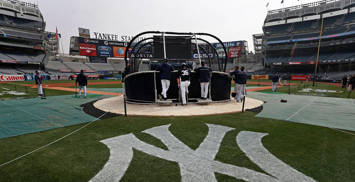 The Yankees made history by hiring a women as a full-time hitting coach. (Photo by Jim Davis/The Boston Globe via Getty Images)