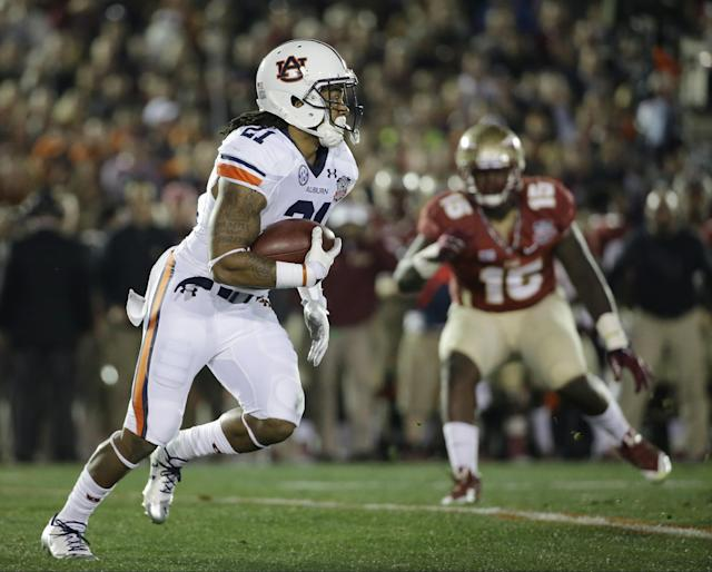 Auburn's Tre Mason runs during the first half of the NCAA BCS National Championship college football game against Florida State Monday, Jan. 6, 2014, in Pasadena, Calif. (AP Photo/David J. Phillip)