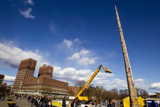 A tower created from Lego bricks is pictured completed in front of Oslo City Hall, April 24, 2010. It measures 30,22 meters and beats last year's record set in Munich by 25 centimetres, according to Norway's media. REUTERS/Scanpix/Heiko Junge