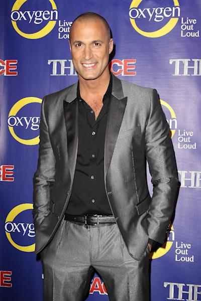 "This Feb. 5, 2013 photo released by Starpix shows photographer Nigel Barker at the premiere of the Oxygen network series, ""The Face,"" in New York. Naomi Campbell, along with models Coco Rocha and Karolina Kurkova, are coaches to aspiring models in a competition to find the next face of beauty retailer ULTA Beauty. The show, hosted by fashion photographer Nigel Barker, premieres on Feb. 12 at 9 p.m. EST on Oxygen. (AP Photo/Starpix, Kristina Bumphrey)"