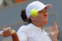 Poland's Iga Swiatek plays a shot against Sofia Kenin of the U.S. in the final match of the French Open tennis tournament at the Roland Garros stadium in Paris, France, Saturday, Oct. 10, 2020. (AP Photo/Michel Euler)