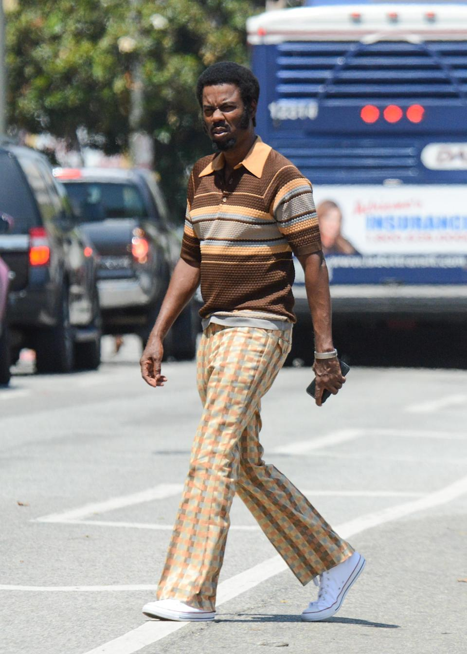 Chris Rock spotted on set in a '70s ensemble. (Photo: Getty Images)