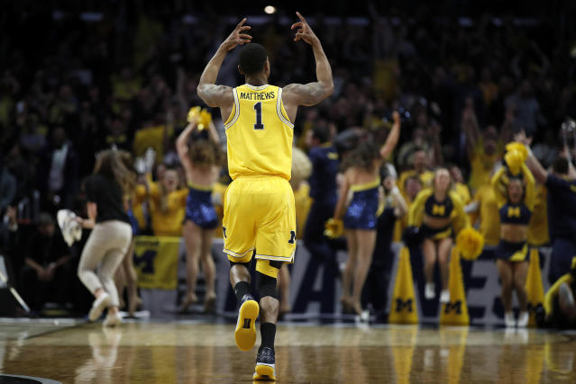 Michigan guard Charles Matthews (1) celebrates after scoring on a 3-oint basket against Texas A&M during the first half of an NCAA men's college basketball tournament regional semifinal Thursday, March 22, 2018, in Los Angeles. (AP Photo/Jae Hong)