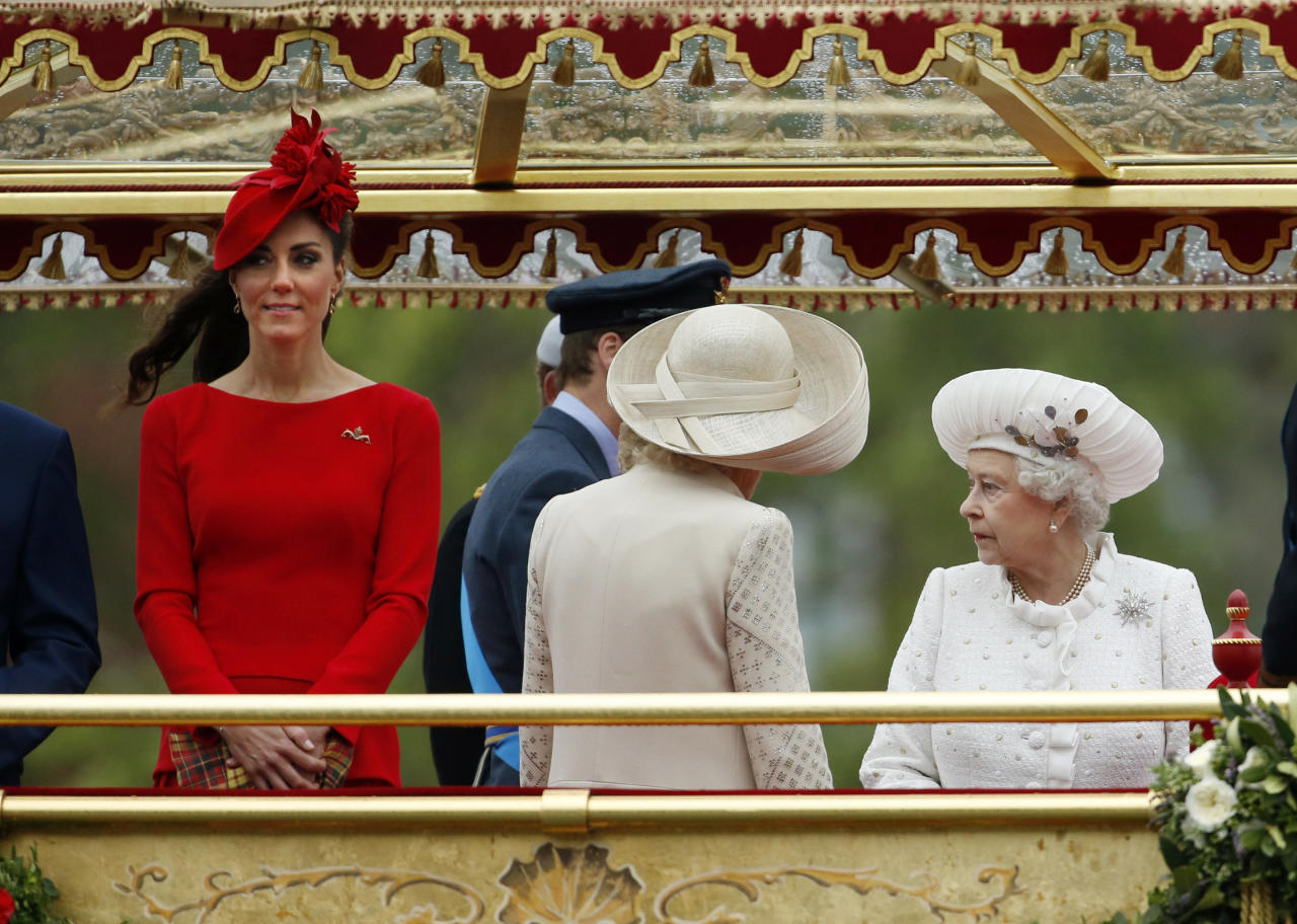Britain's Queen Elizabeth II, right, and Kate Duchess of Cornwall, left, stand on the royal barge, the principal boat of a flotilla of 1,000 vessels, on the River Thames, during a river pageant to celebrate the Queen's Diamond Jubilee in London, Sunday, June 3, 2012. An armada of vessels, from historic sailboats and barges to kayaks, lifeboats and military launches, took part in Sunday's river pageant to mark the queen's 60 years on the throne. (AP Photo/Matt Dunham, Pool)