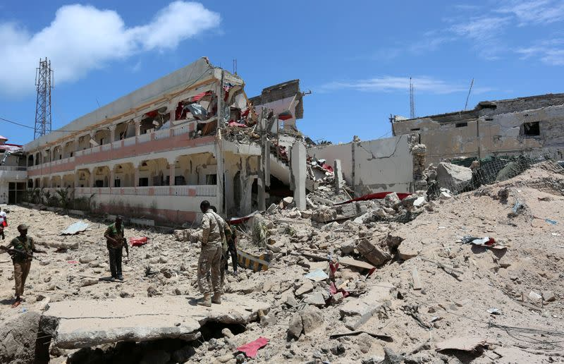 FILE PHOTO: FILE PHOTO: Security forces stand at the SYL hotel that was partly destroyed following a car bomb claimed by al Shabaab Islamist militants  outside the president's palace in the Somali capital of Mogadishu